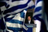 Leader of the Greek conservative party New Democracy Antonis Samaras gives a pre-election speech in Athens. The head of Greece's conservatives said he aimed to win enough votes in Sunday's election to be able to govern without coalition partners, despite opinion polls suggesting this is a tall order