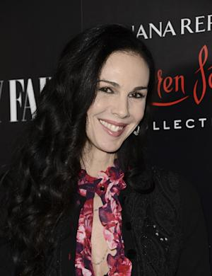FILE - This Nov. 19, 2013 file photo shows fashion designer L'Wren Scott at the Banana Republic L'Wren Scott Collection launch party at the Chateau Marmont in West Hollywood, Calif. Scott, a fashion designer, was found dead, Monday, March 17, 2014, in Manhattan. (Photo by Dan Steinberg/Invision/AP, File)