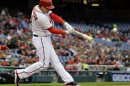 Washington Nationals' Ryan Zimmerman hits a single during the first inning of a baseball game against the Philadelphia Phillies at Nationals Park, Friday, May 24, 2013, in Washington. (AP Photo/Alex Brandon)