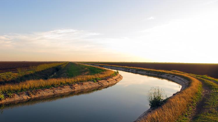 In this Feb. 13, 2012 photo, six and half miles of canal bring water from the Rio Grande to the Donna Reservoir in Donna, Texas.  State and federal researchers have found the highest chemical contamination levels in a section of the canal. (AP Photo/Chris Sherman)