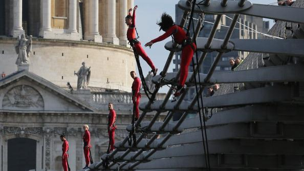 Dancers bungee off the Millennium Bridge as part of the 'One Extraordinary Day' performances on July 15, 2012 in London, England. The dancers are part of American choreographer Elizabeth Streb's 'extreem action' dance group which will perform around London for one day only and form part of the Cultural Olympiad. (Photo by Dan Kitwood/Getty Images)