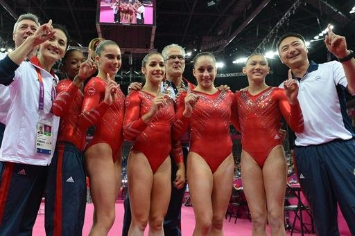 Members of the U.S. women's gymnastics team celebrate winning team
