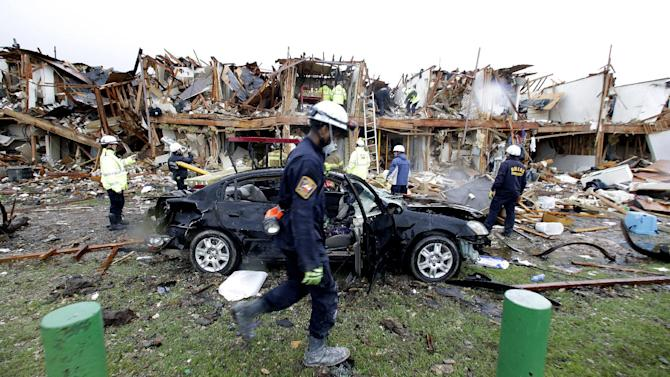 Firefighter conduct search and rescue of an apartment destroyed by an explosion at a fertilizer plant in West, Texas, Thursday, April 18, 2013.  A massive explosion at the West Fertilizer Co. killed as many as 15 people and injured more than 160, officials said overnight.  (AP Photo/LM Otero)