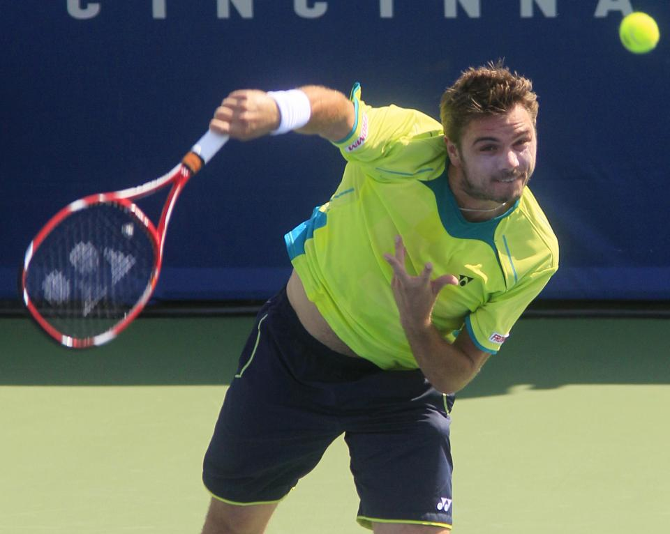 Stanislas Wawrinka, from Switzerland, serves against Milos Raonic, from Canada, during a quarterfinal at the Western & Southern Open tennis tournament on Friday, Aug. 17, 2012, in Mason, Ohio. (AP Photo/Al Behrman)