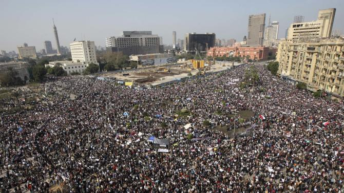 The crowd gathers in Tahrir, or Liberation, Square in Cairo, Egypt, Tuesday, Feb. 1, 2011. Tens of thousands of people flooded into the heart of Cairo Tuesday, filling the city's main square as a call for a million protesters was answered by the largest demonstration in a week of unceasing demands for President Hosni Mubarak to leave after nearly 30 years in power. (AP Photo/Khalil Hamra)