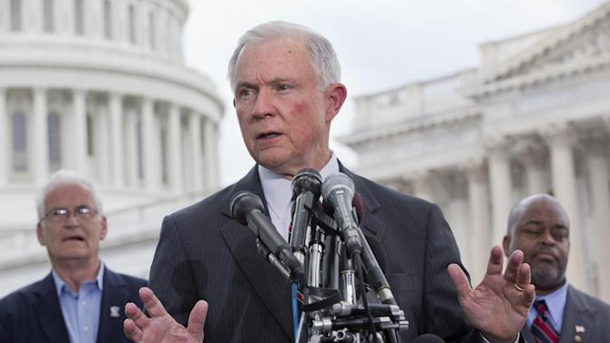 FILE - In this June 20, 2013 file photo, Sen. Jeff Sessions, R-Ala., center, speaks at a news conference hosted by the Tea Party Patriots to oppose the Senate immigration reform bill, on Capitol Hill in Washington. Behind him are Hans Marsen, left, an immigrant from England, and Niger Innis with TheTeaParty.Net. Day after day, Sessions argues against an immigration reform bill that GOP party leaders, and a sizeable share of his Republican colleagues, say is critical to any chance of a national comeback for the party out-of-power in Washington. (AP Photo/Jacquelyn Martin, File)