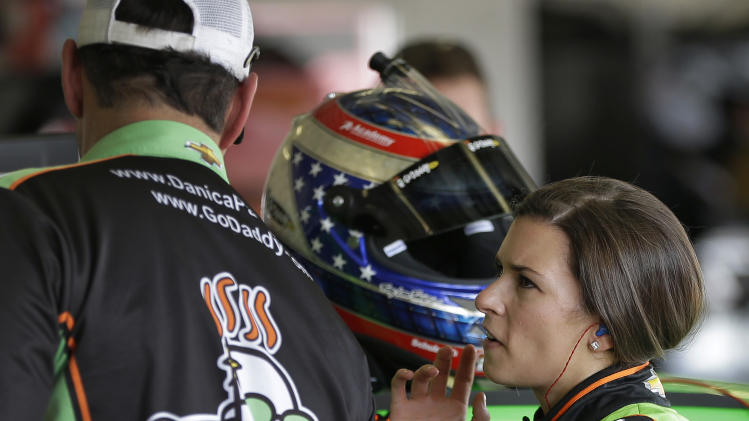 Daytona 500 pole sitter Danica Patrick, right, talks to a crew member after a practice for the Daytona 500 NASCAR Sprint Cup Series auto race Friday, Feb. 22, 2013, at the Daytona International Speedway in Daytona Beach, Fla. (AP Photo/Chris O'Meara)