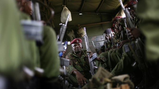 Kenyan General Service Unit officers leave the St Theresa Girl School, used as a polling and counting station, in the Mathare area of Nairobi, Kenya, Wednesday March 6, 2013, as preliminary results trickle in for Monday's general election. Kenya on Monday held its first presidential election since the 2007 vote which ushered in months of tribal violence that killed more than 1,000 people and displaced 600,000 from their homes. Election officials in Kenya began counting ballots by hand on Wednesday after the early returns electronic system broke down, while a top presidential candidate levied charges against Britain's high commissioner that the U.K. is meddling in the vote. (AP Photo/Jerome Delay)