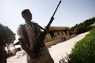 A member of the Libyan security forces secures the US consulate compound in Benghazi in September 2012. Diplomatic security in Benghazi was weak and deteriorating, a former special forces soldier who was the head of a US security team in the Libyan capital was to tell lawmakers Wednesday