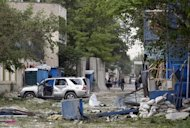 A damaged vehicle is parked at the site of an explosion in Kabul May 24, 2013. Several large explosions rocked a busy area in the centre of the Afghan capital, Kabul, on Friday with Reuters witnesses describing shooting in the area. REUTERS/Omar Sobhani