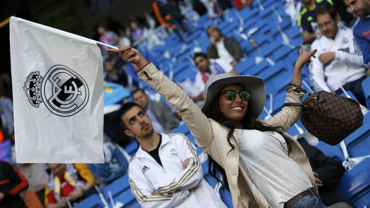 A Real Madrid fan waves her flag ahead of their Champions League semi-final first leg soccer match against Bayern Munich at Santiago Bernabeu stadium in Madrid