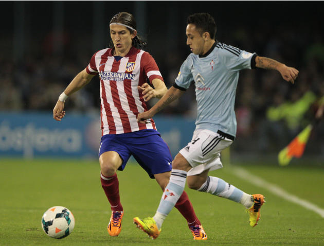 Atletico's Filipe Luis from Brasil, left, in action with Celta's Fabian Orellana from Chile during a Spanish La Liga soccer match at the Balaidos stadium in Vigo, Spain, Saturday, March 8, 201