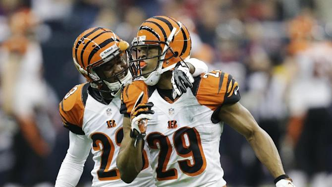 Cincinnati Bengals cornerback Leon Hall (29) celebrates with Terence Newman after scoring a touchdown on an interception from Houston Texans quarterback Matt Schaub during the second quarter of an NFL wild card playoff football game Saturday, Jan. 5, 2013, in Houston. (AP Photo/Eric Gay)