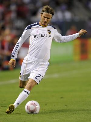 Los Angeles Galaxy midfielder David Beckham (23), of England, works the ball upfield during first half of an MLS soccer match against the Chivas USA, Sunday, Oct. 16, 2011, in Carson, Calif. (AP Photo/Gus Ruelas)