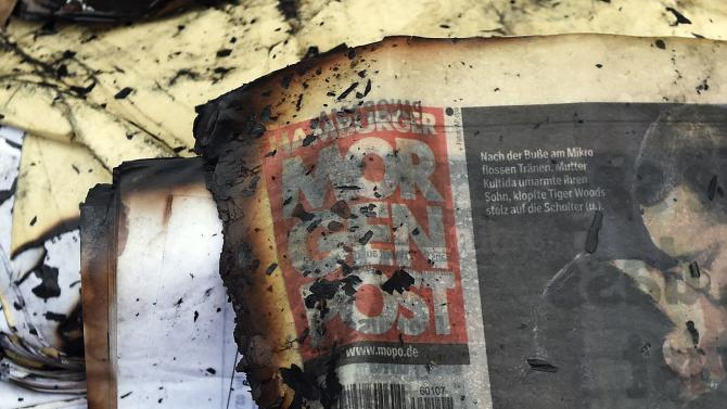 A burned copy of a Hamburger Morgenpost newspaper is pictured among other documents in front of a building of German newspaper Hamburger Morgenpost in Hamburg