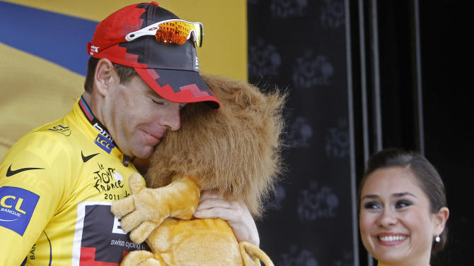 New overall leader Cadel Evans of Australia celebrates on the podium during the 20th stage of the Tour de France cycling race, an individual time trial over 42.5 kilometers (26.4 miles) starting and finishing in Grenoble, Alps region, France, Saturday July 23, 2011.  (AP Photo/Laurent Cipriani)