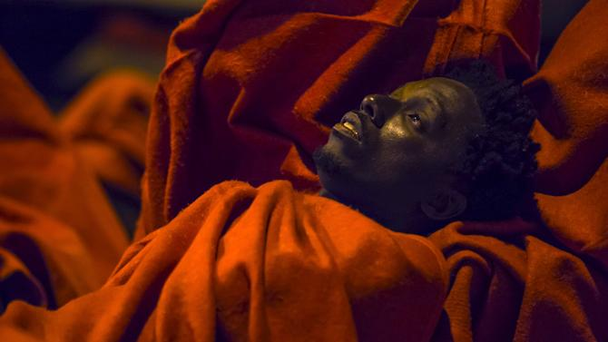 An African migrant rests after arriving at  Maspalomas beach on the Canary Island of Gran Canaria