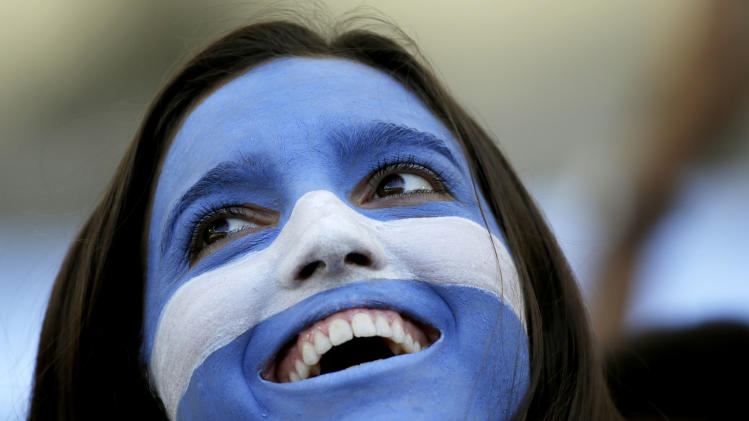 An Argentine supporter waits for the start of the World Cup final soccer match between Germany and Argentina at the Maracana Stadium in Rio de Janeiro, Brazil, Sunday, July 13, 2014. (AP Photo/Felipe Dana)