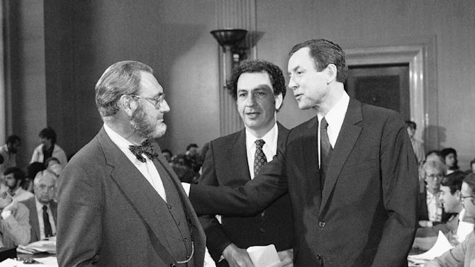 FILE - In this Oct. 1, 1981 file photo, Dr. Everett Koop, left, who had been nominated to be the U.S. surgeon general, chats with Sen. Arlen Specter (R-Pa.), and Orrin Hatch (R-Utah), right, prior to appearing before the Senate Labor and Human Resources Committee which is holding his confirmation hearings on Capitol Hill in Washington.  Former U.S. Sen. Arlen Specter, longtime Senate moderate and architect of one-bullet theory in JFK death, died Sunday, Oct. 14, 2012.  He was 82. (AP Photo/Ron Edmonds, File)