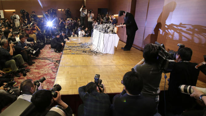 "Mamoru Samuragochi bows during a press conference in Tokyo, Friday, March 7, 2014. The man once lauded as ""Japan's Beethoven"" bowed repeatedly and apologized Friday at his first media appearance since it was revealed last month that his famed musical compositions were ghostwritten and he wasn't completely deaf. (AP Photo/Shuji Kajiyama)"