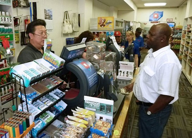 A man buys tickets for the Powerball US lottery with a record $600 million jackpot in Washington, DC, on May 17, 2013