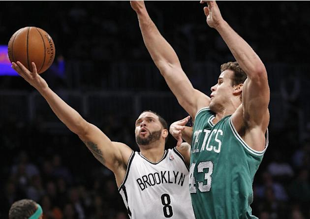 Brooklyn Nets guard Deron Williams (8) looks to shoot over the defense of Boston Celtics forward Kris Humphries (43) in the first half of their their NBA basketball game, Tuesday, Dec. 10, 2013, in Ne