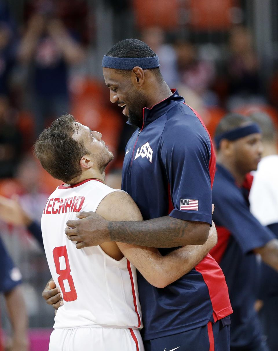 USA's Lebron James, right, visits with Tunisia's Marouan Kechrid (8) following their  preliminary men's basketball game at the 2012 Summer Olympics, Tuesday, July 31, 2012, in London. (AP Photo/Eric Gay)
