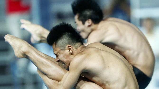 Japan's Sakai and Terauchi perform during the men's synchronised 3 metre springboard preliminary at the Aquatics World Championships in Kazan