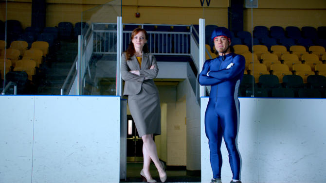 """This advertisement provided by Century 21, shows a scene from the ad """"Smarter, Bolder, Faster,"""" with a Century 21 saleswoman and Olympic speedskating medalist Apolo Ohno. The ad will air during Super Bowl XLVI, Sunday, Feb. 5, 2012. (AP Photo/Century 21)"""