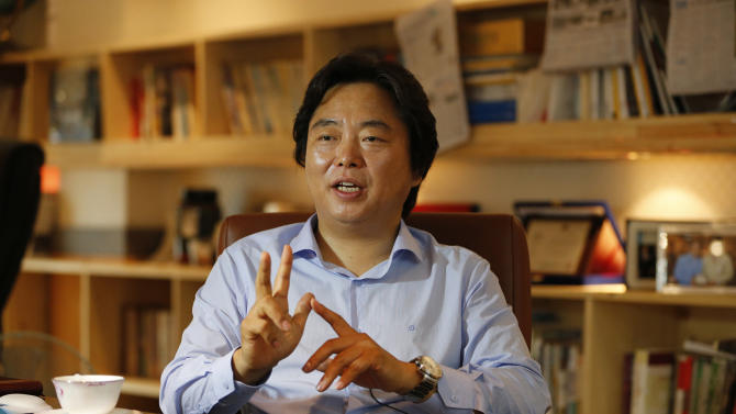 "In this July 18, 2012 photo, Shin Cheol-soo, chief executive of ENA Industry, speaks at his office in Gyeongsan, south of Seoul, South Korea. Shin no longer sees his future in the United States. The South Korean auto parts supplier uprooted his family from Detroit this year and moved home to focus on selling to the new economic superpower: China. ""The United States is a tiger with no power,"" Shin said in his office, where three walls are lined with books, many about China. ""Nobody can deny that China is the one now rising."" (AP Photo/Lee Jin-man)"
