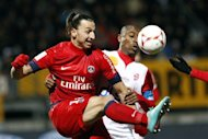 Paris Saint Germain's Swedish forward Zlatan Ibrahimovic, left, challenges for the ball with Nancy's Andre Luiz Silva Do Nascimento during their French League One soccer match in Nancy, eastern France, Saturday Oct. 27, 2012. (AP Photo/Mathieu Cugnot)