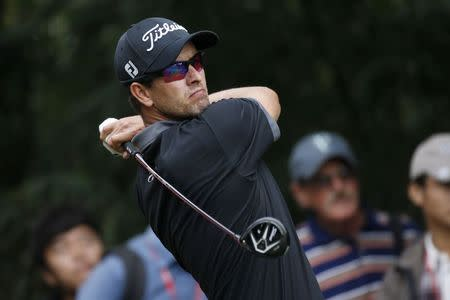 Adam Scott of Australia tees off on the ninth hole during the second round of the WGC-HSBC Champions golf tournament in Shanghai