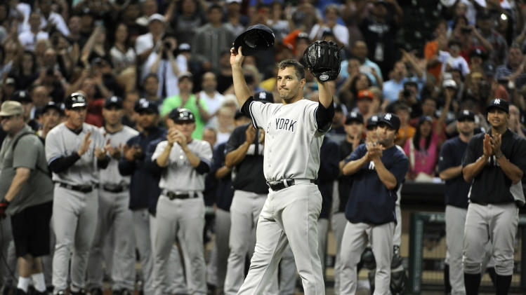 New York Yankees starting pitcher Andy Pettitte acknowledges the fans and players after earning a win over the Houston Astros in his final Major League baseball game in a baseball game Saturday, Sept. 28, 2013, in Houston. (AP Photo/Pat Sullivan)