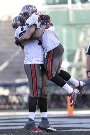 Tampa Bay Buccaneers running back Doug Martin, right, is congratulated by center Jeremy Zuttah after scoring on a 70-yard touchdown run against the Oakland Raiders during the fourth quarter of an NFL football game in Oakland, Calif., Sunday, Nov. 4, 2012. (AP Photo/Marcio Jose Sanchez)