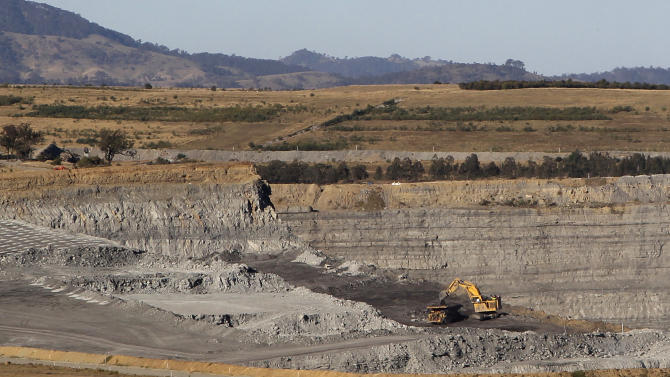 "This Sept. 11, 2012 photo shows a coal mine near Gunnedah, Australia, 450 kilometers (280 miles) northwest of Sydney. Gunnedah, whose previous heyday came during the 1950s wool boom, may be undergoing one of its biggest transformations since it was settled in 1856, says former Mayor Adam Marshall. ""We did have a mini coal boom in the early 1980s, but nothing on the scale which we're seeing now."" (AP Photo/Rob Griffith)"