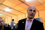 British Ambassador to Iraq, Michael Aron speaks to the reporters outside the negotiation room in Baghdad where the world powers attended the second day of talks with Iran over it's contested nuclear programme