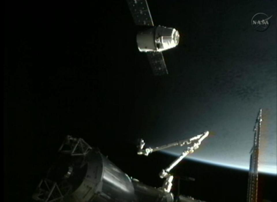This image provided by NASA-TV shows the SpaceX Dragon commercial cargo craft, top, as Dragon approaches the International Space Station, Friday, May 25, 2012. Dragon is scheduled to spend about a week docked with the station before returning to Earth on May 31 for retrieval. (AP Photo/NASA)