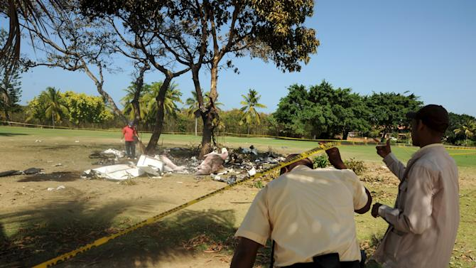 Rescue workers inspect the site of a small plane crash in Bavaro