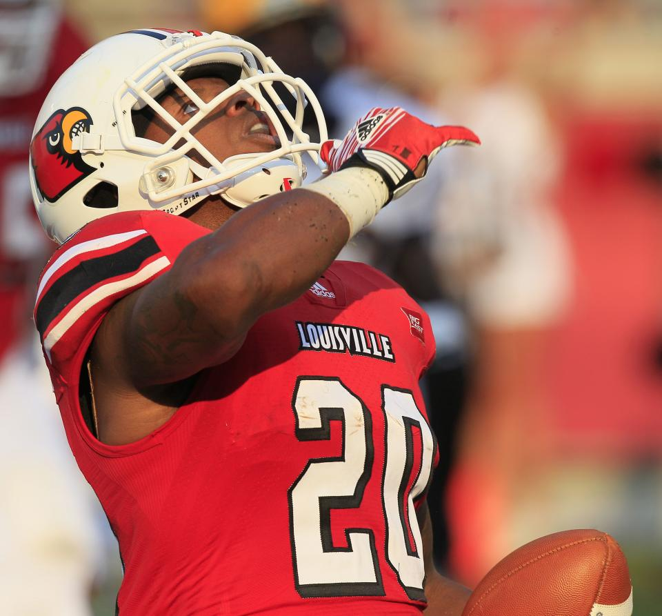 Louisville's Victor Anderson gestures after scoring a touchdown during the first half of NCAA college football game against Murray State, Thursday, Sept. 1, 2011, in Louisville, Ky. (AP Photo/Ed Reinke)