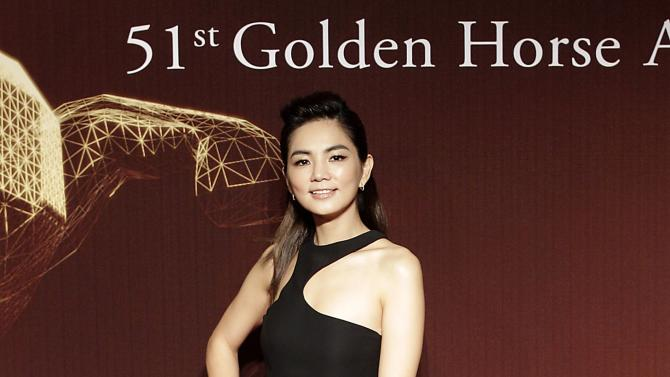Taiwanese actress and singer Ella from Taiwan music group S.H.E. poses on the red carpet at the 51st Golden Horse Film Awards in Taipei