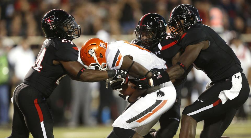 No. 18 Oklahoma St upends No. 15 Texas Tech 52-34