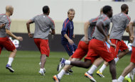 Jurgen Klinsmann, center, coach of the U.S. men's soccer team, leads his team during practice in preparation for Tuesday's international friendly game against Ecuador, Monday, Oct. 10, 2011, in Harrison, N.J. (AP Photo/Julio Cortez)