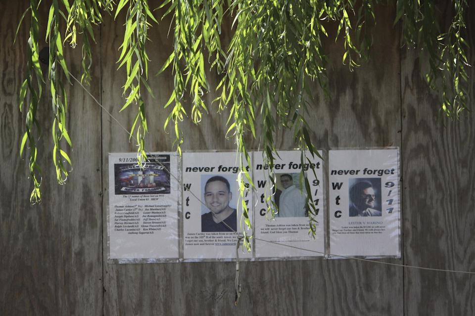 This Wednesday, Aug. 10 2011 photo shows posters on a wall of the garden behind a tent which houses a chapel and a storage of the remains of victims of the attacks on the World Trade Center near Chief Medical Examiner Office Forensic Biology Lab in New York. (AP Photo/Mary Altaffer)