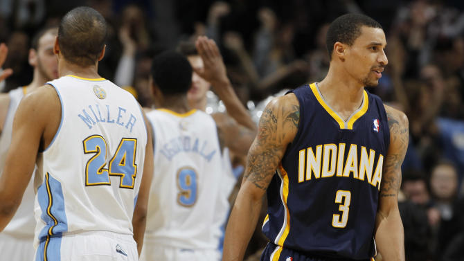 Indiana Pacers guard George Hill, front right, turns away as Denver Nuggets guard Andre Miller, front left, joins teammates as they congratulate Andre Iguodala after he hit the winning free throw in the fourth quarter of the Nuggets' 102-101 victory in an NBA basketball game in Denver on Monday, Jan. 28, 2013. (AP Photo/David Zalubowski)