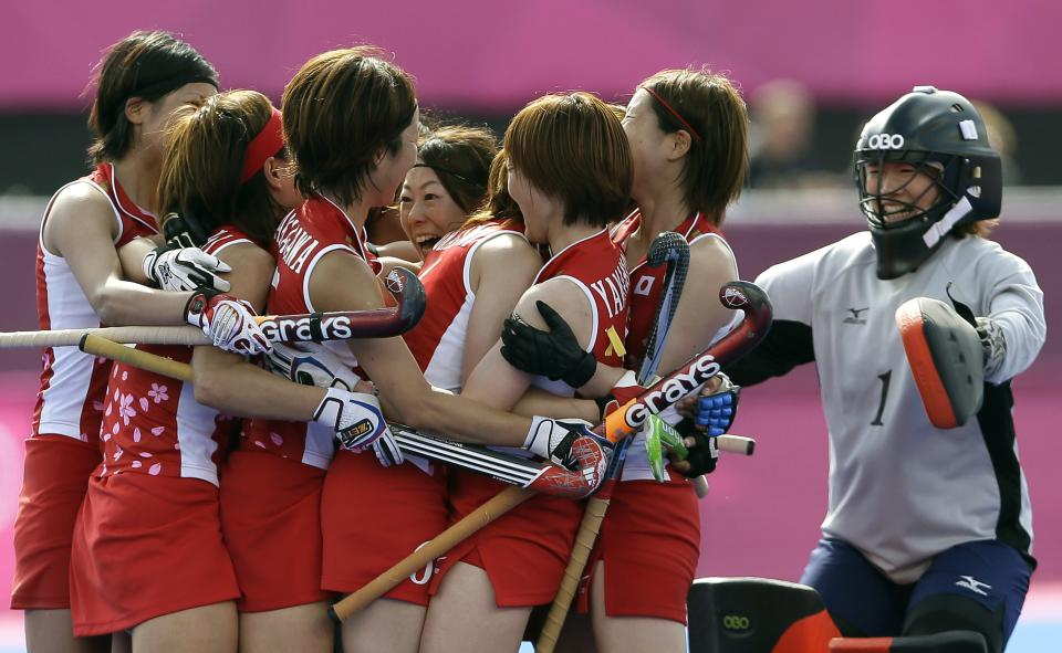 Japan's players celebrate winning their classification hockey match against South Africa at the Riverside Arena at the 2012 Summer Olympics, London, Wednesday, Aug. 8, 2012. (AP Photo/Kirsty Wigglesworth)
