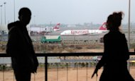 A Kingfisher Airlines Airbus A319 is parked at Indira Gandhi international airport in New Delhi, March 2012. Shares of India's troubled Kingfisher Airlines plunged to a record low on fears that a government move to allow foreign airlines to pick up stakes in domestic carriers may be delayed