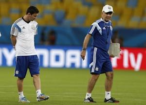Argentine national soccer team player Messi stands next to coach Sabella during a training session for the 2014 World Cup at the Maracana stadium in Rio de Janeiro