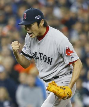 Boston Red Sox's Koji Uehara celebrates after the Red Sox defeated the Detroit Tigers 1-0 in Game 3 of the American League baseball championship series Tuesday, Oct. 15, 2013, in Detroit. (AP Photo/Paul Sancya)