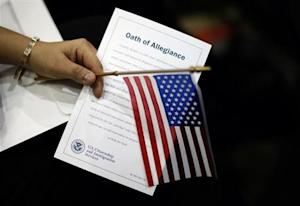 A woman holds the Oath of Allegiance at a naturalization ceremony for new U.S. citizens in Los Angeles