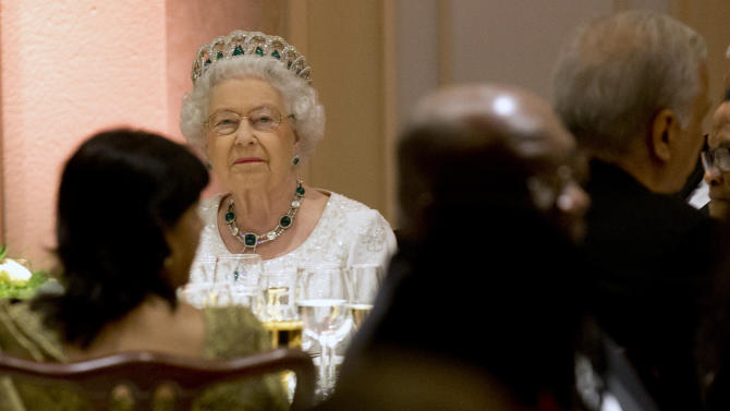 Queen Elizabeth II sits at a gala dinner during the CHOGM Commonwealth Heads of Government Meeting, in Attard, Malta, Friday, Nov. 27, 2015. (AP Photo/Alessandra Tarantino)